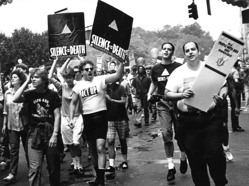 5 Members of ACT UP hold up signs and placards during the Gay and Lesbia...