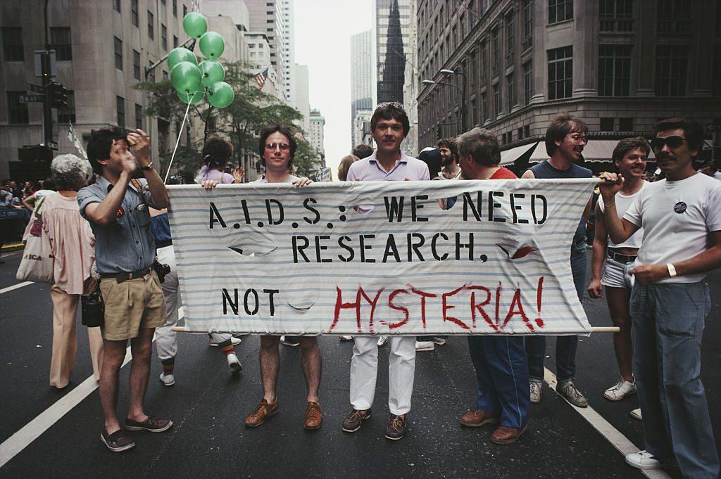 8 Marchers on a Gay Pride parade through Manhattan, New York City, carry...
